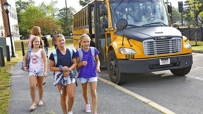 Kids file off the bus on the first day at Milton's Collocot school on Wednesday, August 27, 2019. Greg Derr/The Patriot Ledger