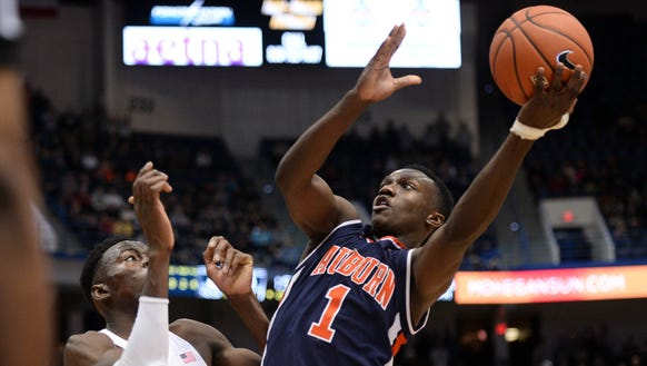 Auburn point guard Jared Harper (1) vs UConn on Friday,