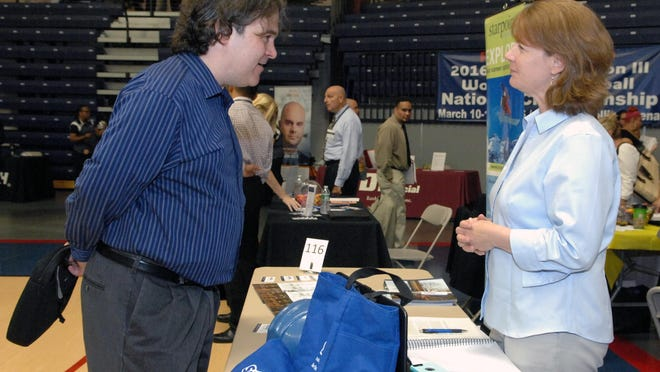 Joe Deuidicidus of Middletown (left) speaks with Tory Donnelly of Summit Drilling at the Monmouth County Job Fair at Brookdale Community College.