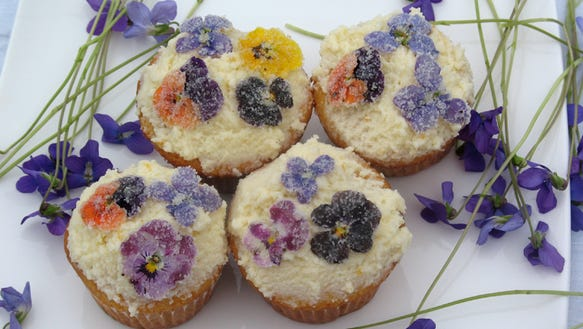 Sugared flowers make a fanciful topping for desserts.