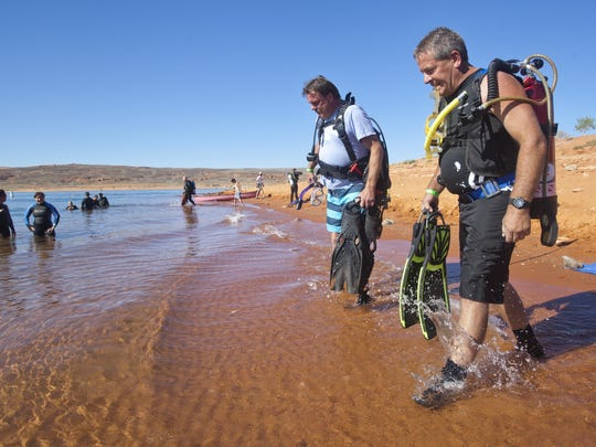 Greg Winkler, from St. George, and Manuel Quintanilla, from Hurricane, enter the water at the start of the 2nd annual Ultimate Diver Challenge at Sand Hollow Reservior, Saturday, August 16, 2014.