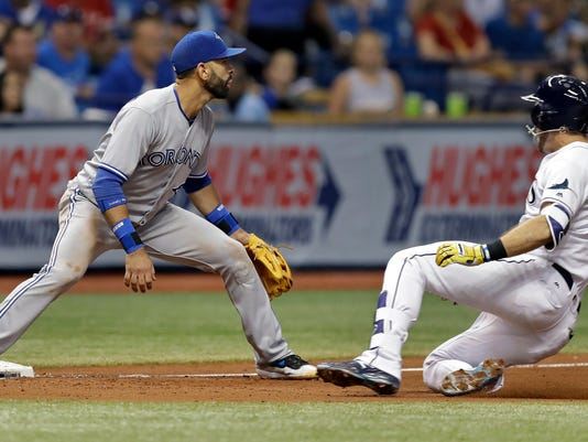 Tampa Bay Rays' Evan Longoria, right, slides into third base ahead of the throw to Toronto Blue Jays third baseman Jose Bautista during the fifth inning of a baseball game Tuesday, Aug. 22, 2017, in St. Petersburg, Fla. longoria was credited with a double and took third on an error by Blue Jays center fielder Ezequiel Carrera. (AP Photo/Chris O'Meara)