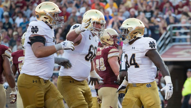 Notre Dame running back Tony Jones Jr. (34) celebrates with offensive lineman Mike McGlinchey (68) after a touchdown in against Boston College.