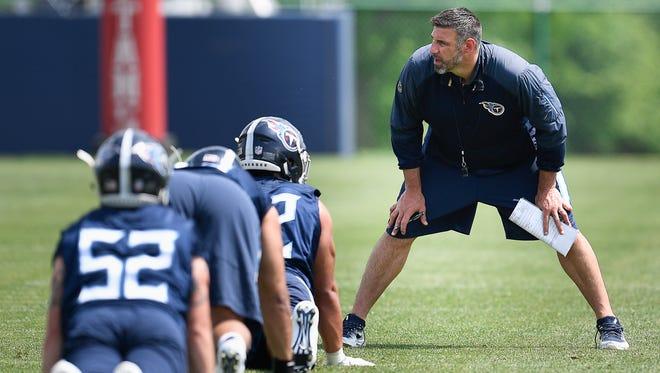 Titans head coach Mike Vrabel talks with new players as they warm up before the start of their rookie minicamp at Saint Thomas Sports Park on Saturday, May 12, 2018, in Nashville.