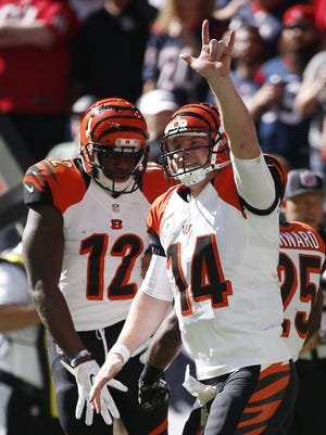 Bengals quarterback Andy Dalton celebrates his second-quarter touchdown pass to wide receiver Mohamed Sanu (12).