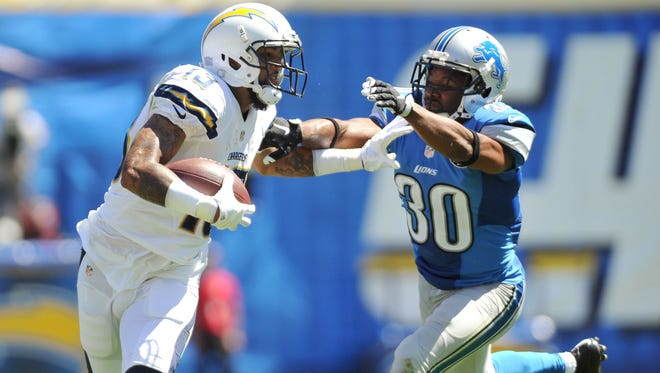 Chargers wide receiver Keenan Allen stiff arms Lions defensive back Josh Wilson after a reception in the first half of the Lions' 33-28 loss Sunday in San Diego.