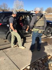 U.S. Marshals members arrest John Mercado, 23, on Tuesday,