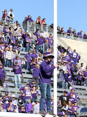 A lone Kansas State Wildcats fan stands on a goal post following a K-State's win against the Oklahoma Sooners at Bill Snyder Family Stadium. K-State announced Monday that Bill Snyder Family Stadium will have about 25% capacity for games this season.