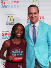 Peyton Manning poses with Female Tennis Player of the Year Tiffani Nash (Loyola) at the Shreveport Times Sports Awards at the Shreveport Convention Center.