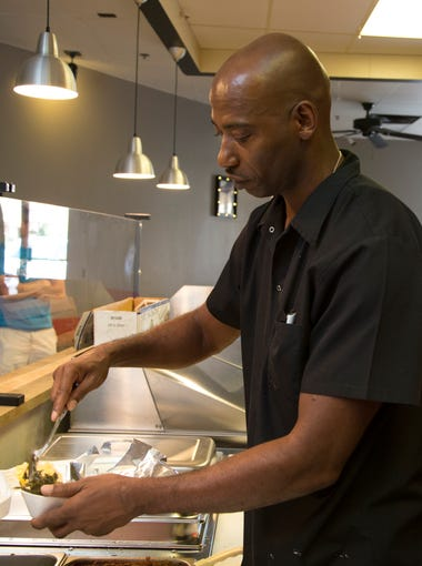 Antoine Smith works in the kitchen at Ibby's Fish and Chicken in Chandler.