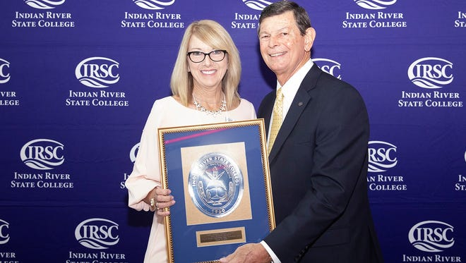 Dr. Edwin Massey, Indian River State College president, presents Donna Sizemore with the 2018 Anne R. Snyder Department Chair Excellence Award at the IRSC Foundation's annual faculty welcome breakfast and awards. The award is presented to a department chair who exhibits outstanding leadership, contributes to toward the achievement of the college mission, demonstrates curricular innovation and is committed to student success and completion.