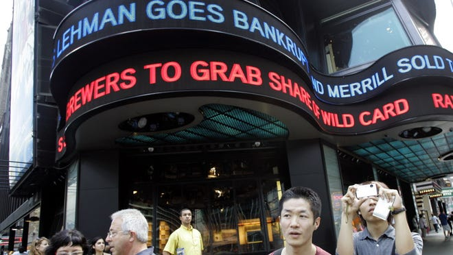 New York's Times Square shows news ticker about Lehman Bros. failing on Sept. 15, 2008.