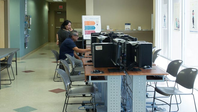 Job seekers work at computers in the New Mexico Workforce Connection office in Las Cruces in September 2017.