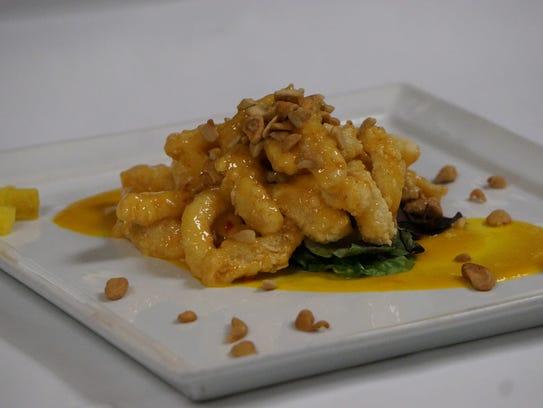The calamari in a sweet chili aioli with cashews and