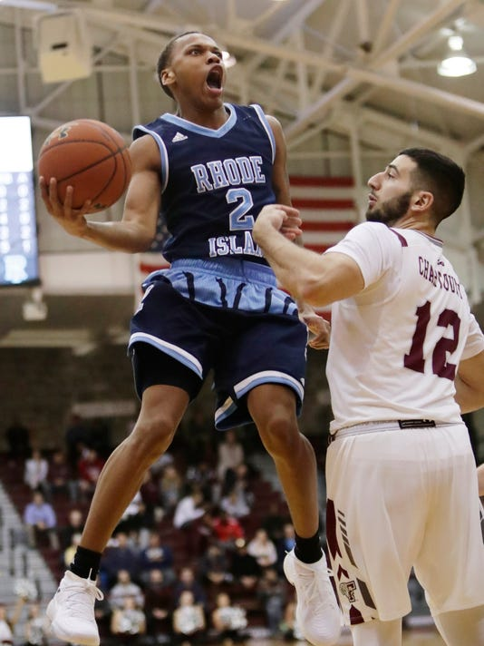 Rhode Island's Fatts Russell (2) drives past Fordham's Joseph Chartouny (12) during the second half of an NCAA college basketball game Wednesday, Jan. 24, 2018, in New York. Rhode Island won 78-58. (AP Photo/Frank Franklin II)