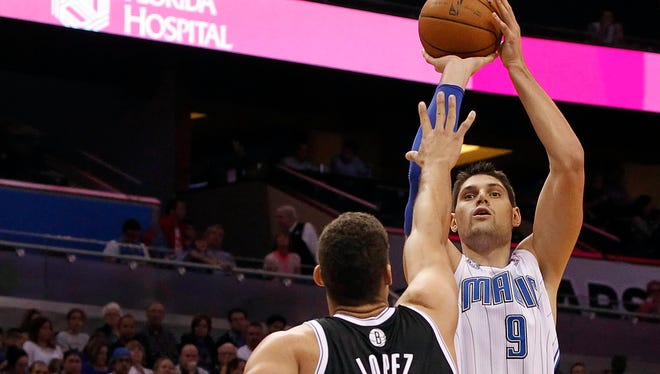 Magic center Nikola Vucevic shoots over Nets center Brook Lopez during the second half at Amway Center.