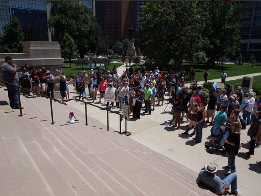 Protesters gather at the Indiana Statehouse on Saturday,