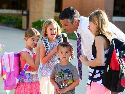 Victor Roberts chats with his daughters, Jenna, a fifth-grader,