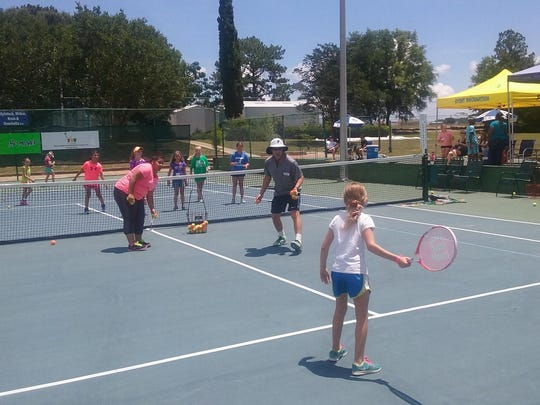 The annual Racquet Round-Up, shown during a previous year's event, has helped introduce tennis to youth from across the Pensacola area.