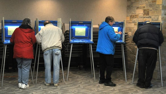 Voters cast ballots on April 3 at the Menomonee Falls Public Library.