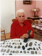 In a picture from the 1990s, the late Loren Sanderson displays the arrowheads found on his family's farm.