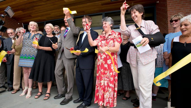 Dignitaries cut the ribbon during the opening of the Vermont Psychiatric Care Hospital in Berlin on Tuesday.