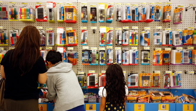 Consumers spent cautiously during the summer's back to school shopping season.  (Bloomberg, Patrick T. Fallon)