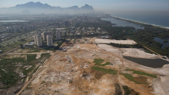 This June 27, 2014 file photo, shows an aerial view of the Rio 2016 Olympic golf course under construction in Rio de Janeiro, Brazil. Rio de Janeiro's Olympic golf course faces an uncertain future after a court proposed  Sept. 3  that the under-construction layout should be modified to meet environmental concerns.