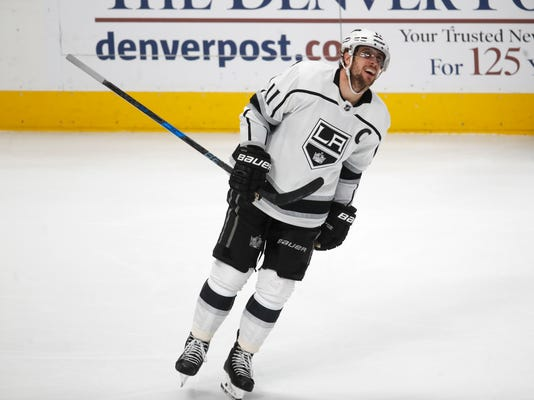 Los Angeles Kings center Anze Kopitar smiles after scoring his fourth goal of the night against the Colorado Avalanche, during the third period of an NHL hockey game Thursday, March 22, 2018, in Denver. The Kings won 7-1. (AP Photo/David Zalubowski)
