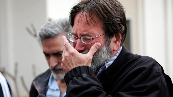 Richard Martinez who says his son Christopher Martinez was killed in Friday night's mass shooting that took place in Isla Vista, Calif., breaks down as he talks to media outside the Santa Barbara County Sheriff's Headquarters on Saturday, May 24, 2014, in Santa Barbara, Calif.