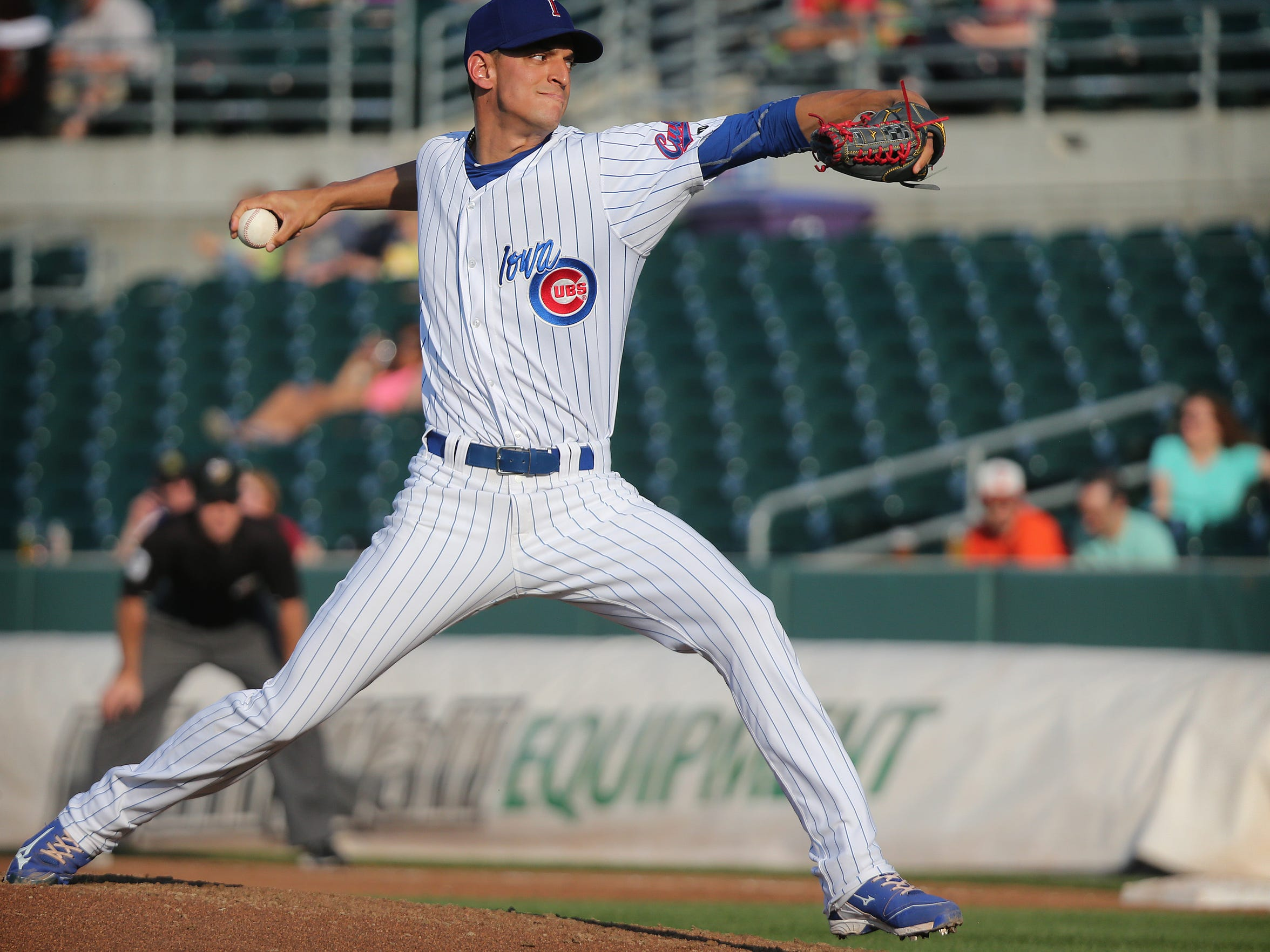 Iowa Cubs pitcher Armando Rivero pitches during a game