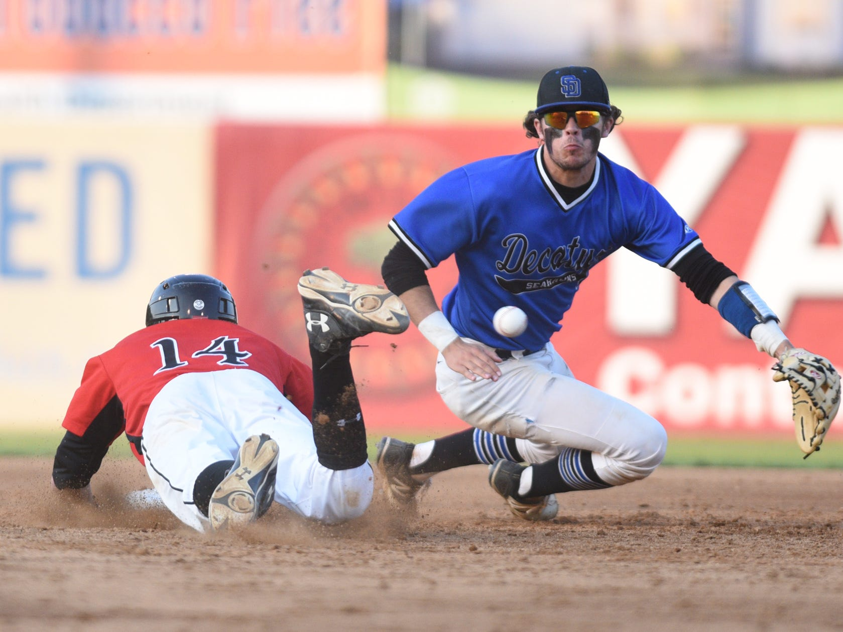 Colonel Richardson's Jaret Bennett slides into second ahead of the throw to Stephen Decatur's Justin Meekins.