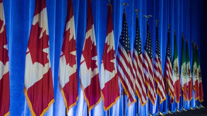 The flags of Canada, the United States and Mexico at NAFTA talks in 2016 in Washington.