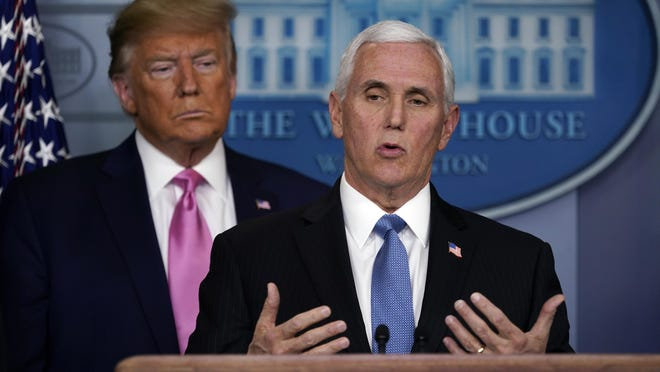 President Donald Trump listens as Vice President Mike Pence speaks during a news conference about coronavirus in the Brady Press Briefing Room of the White House, Wednesday, Feb. 26, 2020, in Washington. (AP Photo/Evan Vucci) ORG XMIT: DCEV320