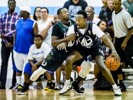 Tum Tum Nairn, left, defends Michigan State teammate Josh Langford during their Moneyball Pro-Am game Thursday, June 30, 2016.