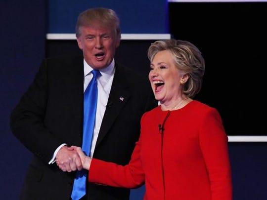 Republican presidential nominee Donald Trump and Democratic presidential nominee Hillary Clinton shake hands during the presidential debate at Hofstra University in Hempstead, N.Y., Monday.