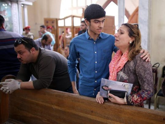Egyptians look in shock at the scene of a bomb explosion inside Mar Girgis church in Tanta, Egypt.