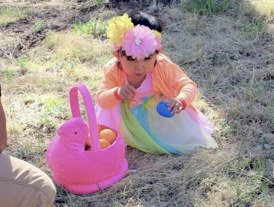 A little girl found just the right egg for hre pretty