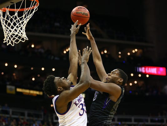 NCAA Basketball: Washington at Kansas