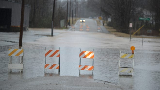 """Water flooded parts of Bemis Saturday afternoon during a temperature spike. Johnny Byrd, a worker for the City of Jackson Health and Sanitation department, said that, """"You've got more water than the ditches can carry..."""" after looking into the Bemis flooding. According to Byrd homes in the area will not be hurt. Pictured is the intersection at N. Kentucky street and B. street."""