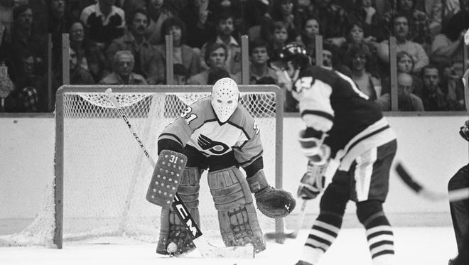 Philadelphia Flyers' goalie Pelle Lindbergh prepares for a goal shot by Pittsburgh Penguins' right wing Rick Kehoe in the first period of play at the Spectrum in Philadelphia on Thursday, Oct. 28, 1982. The shot scored, Kehoe's seventh for the season, the Penguins' first in the game. (AP Photo/P. Morgan)