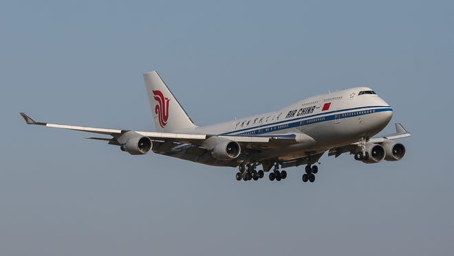 An Air China Boeing 747 is seen in flight on June 6, 2013.