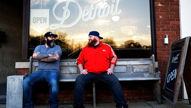 Michael Haddad and Shaun Walford outside of the Detroit Grooming Barber Shop.