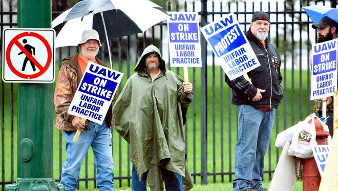 In hope of gaining a new contract, union employees, from left, Dennis Wolfe, of East Berlin, Dave Welsh, of Dover, Scott Berkebile, of Red Lion, and Curtis Ross, of West York, represent the UAW Local 1872 as they stand outside the South Richland Avenue entrance to Johnson Controls in Spring Garden Township, Tuesday, Aug. 29, 2017. Dawn J. Sagert photo