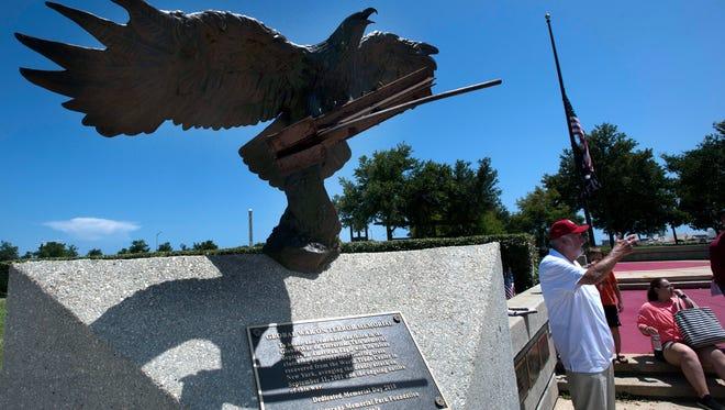 Veterans Memorial Park board members unveil the new Global War on Terror memorial on May 24.