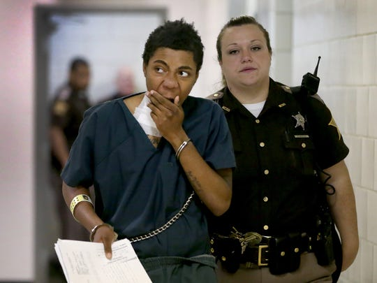 Simeon Adams is escorted into court Thursday morning