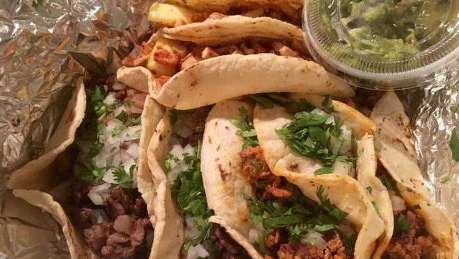 Tacos (top: al pastor, bottom right: longaniza, bottom left: asada) from La Poblanita in south Fort Myers.