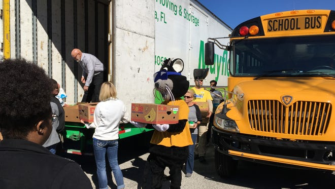 The Escambia County School District delivers food for MANNA Food Pantries annual Fill the Mayflower.