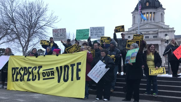 Supporters of a voter-approved ethics law protested the South Dakota Senate's vote supporting its repeal Wednesday night in Pierre.