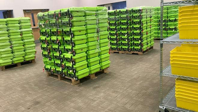 In this Dec. 14, 2017 photo, containers for secure ballot handling sit on pallets at the Franklin County Board of Elections in Columbus. The U.S. Supreme Court will soon hear a case about Ohio's efforts to remove inactive voters from its rolls, which has become a flashpoint in a nationwide fight between Democrats and Republicans over access to the polls. The Trump administration is supporting Ohio's Republican-led government in defending its method for pruning voter rolls. Civil rights groups argue that federal law prohibits states from dropping eligible voters who have chosen not to cast ballots in some elections.